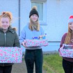 Students Casey Mackenzie, Carla Cameron-Smith and Caitlin Collett delivered more than 30 hampers to elderly and deserving citizens.