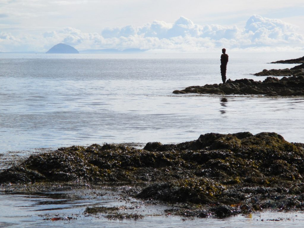 Taken by Elizabeth McTaggart from Saddell Bay, the photo shows the Antony Gormley sculpture GRIP looking reflectively across the Kilbrannan Sound and Firth of Clyde towards Alisa Craig and the Ayrshire coast.