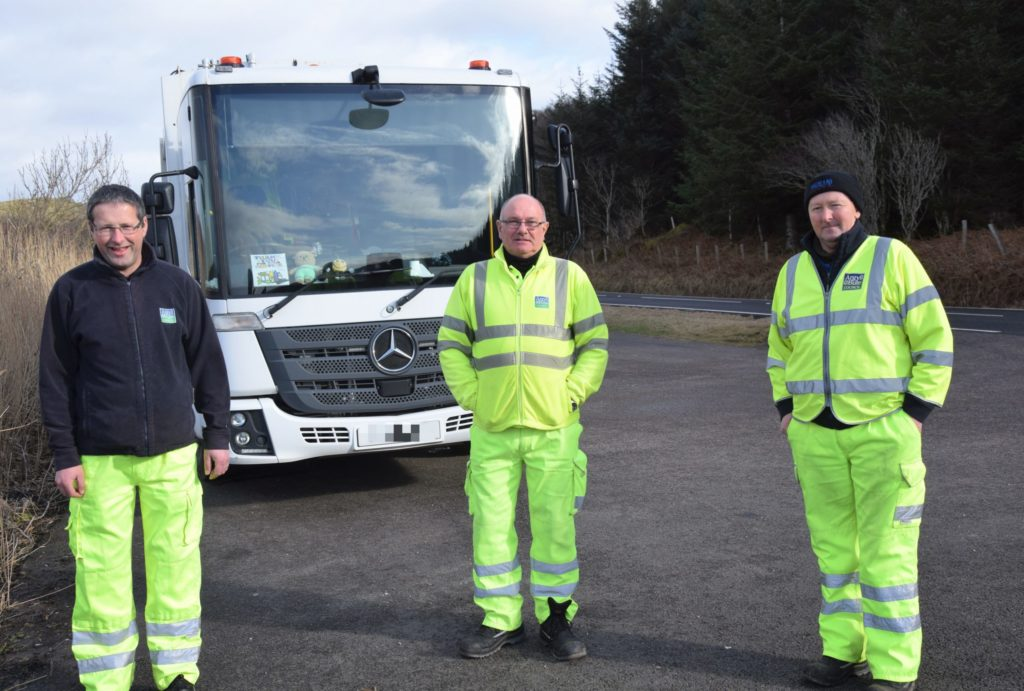 Jimmy Robertson, centre, on his final day working for Argyll and Bute Council, with colleagues Alex Black, left, and John Mason, right.