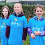 From left: Emma Johnston, Abigail McAllister and Jessica McGeachy with their medals at the end of the sponsored walk.