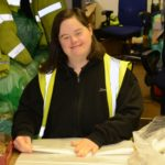 Jenna Campbell packing recycling sacks at Kintyre Recycling Limited.