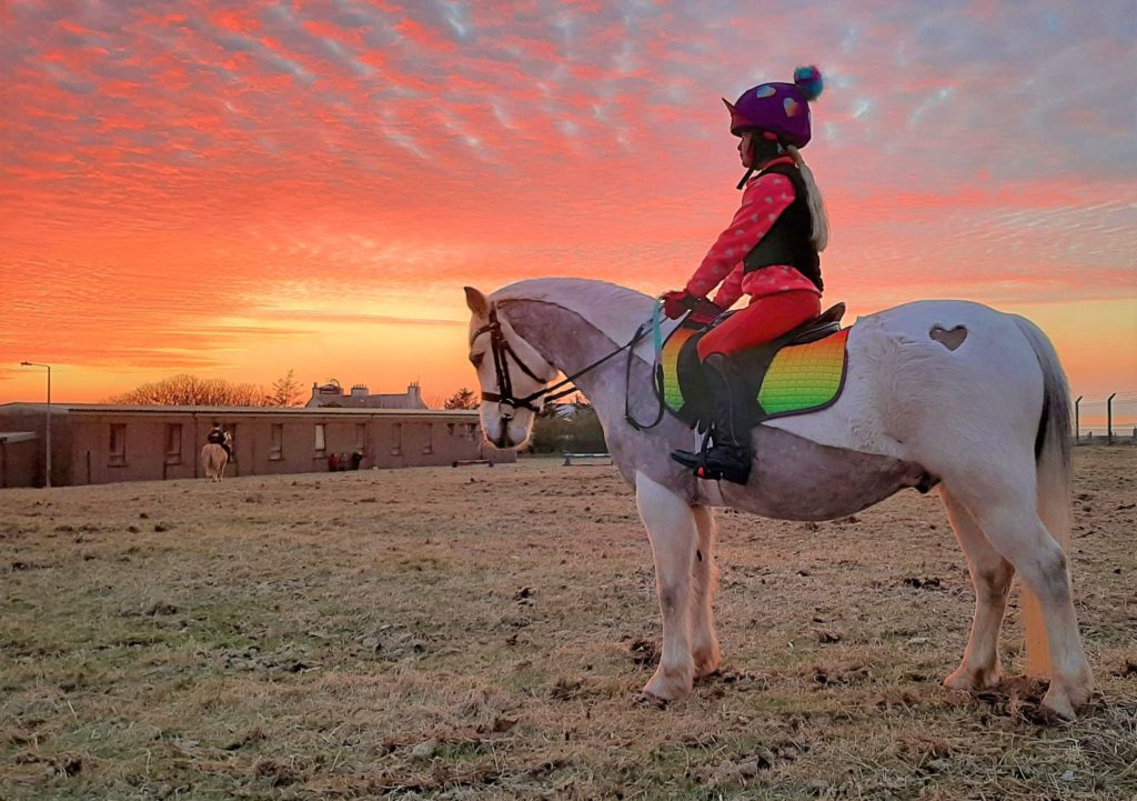 Jen Ralston captured this shot of her eight-year-old daughter Amelie catching the last rays of sun on Monday evening as she rode her a Welsh section A pony Porridge, officially named Heniarth Norman Stanley Fletcher, near Campbeltown.
