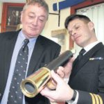 In 2011: Commander Keri Harris of HMS Campbeltown, right, presents the original telescope given to the ship by the RNLI back to George Bradley, operations manager of Campbeltown Lifeboat.