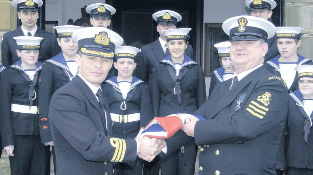 In 2011: Commanding Officer of HMS Campbeltown, Keri Harris, presented Donnie Cameron of TS Campbeltown Sea Cadets with an ensign, something to remember the town's namesake ship by, after a service at Lorne and Lowland Church on Sunday; it was one that had been used by the ship at sea.