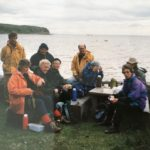 Enjoying a picnic on Sanda Island in 1991 are two boatmen, in yellow, and from left to right: Margaret Ralston, Betty Maxwell, Ken and Betty Holland, Alex Ronald and Margaret Barr.