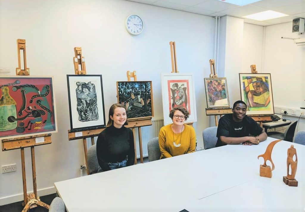 Dr Kate Cowcher, centre, with St Andrews alumni and project research assistants, Meredith Loper, left, and Elikem Logan, right, with modern African artworks at Lochgilphead High School in 2019.
