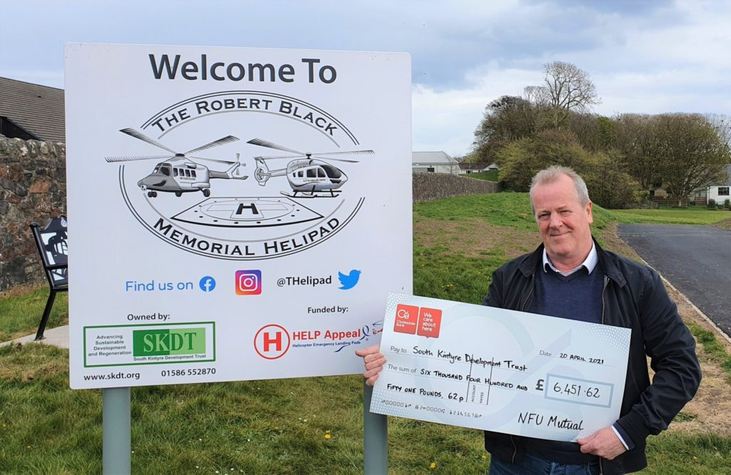 SKDT manager Eric Spence accepted the £6,451.62 donation.
