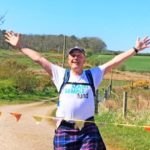 Southend's Andrew Rathey received a raucous welcome home as he crossed a bunting finish line after completing Scotland's Virtual Kiltwalk challenge.