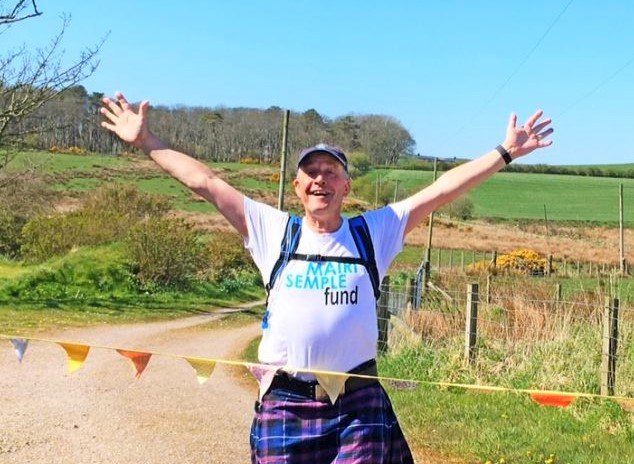 Kiltwalkers cross paths during charity challenges