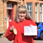 Jenny Souden, a Dellwood Hotel assistant, also known as a 'Dellwood dolly', holding the lost room key and the note from kind-hearted postman Steve.