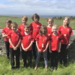Pupils at Glenbarr Primary School, who have taken on the challenge of completing their virtual MOKRUN together, modelling the T-shirt and medal which junior participants will receive.