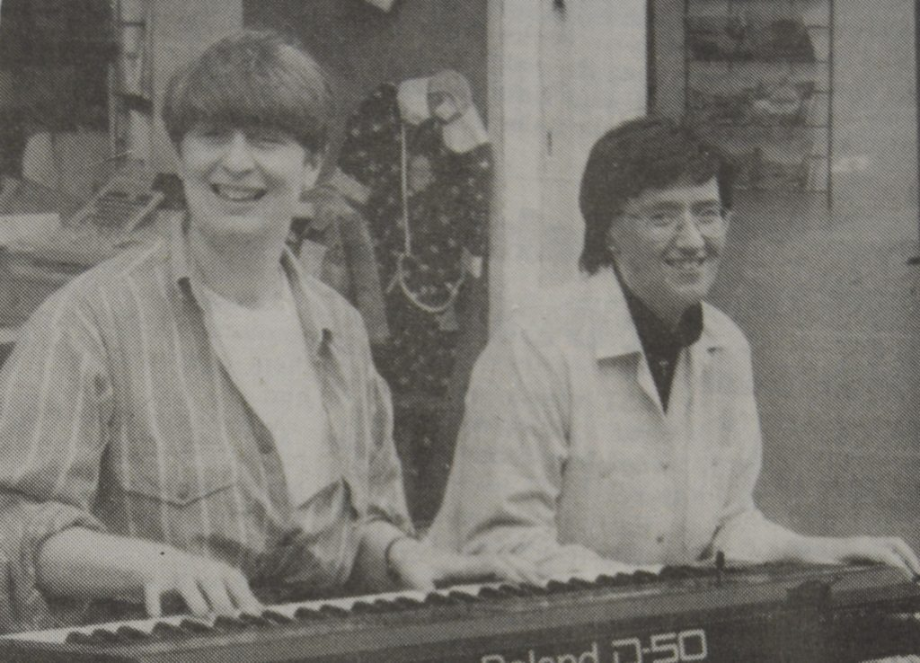 In 1996: Cath Black and Catriona Hood braved showers to help publicise the Lorne and Lowland Church Mayfest.