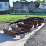 The sculpture, which will feature six weathered steel rings representing whisky cask hoops, is currently under construction.
