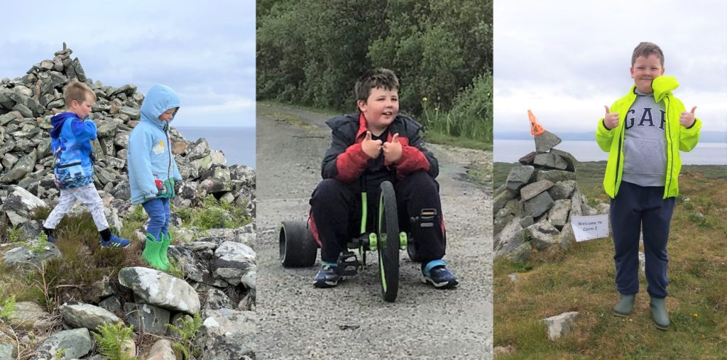 From left: Youngsters from Gigha Primary School make it to the first of three cairns; participants walked and scooted throughout the challenge; and the three peaks challenge gets a thumbs up from this pupil standing at the second cairn.