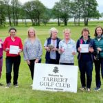 Georgie Dickson, winner of Tarbert Golf Club's open competition, centre, with fellow prize-winners and sponsor.