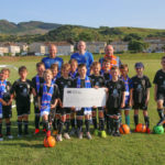 Campbeltown Loyal Rangers Supporters' Club members Jamie McEachran, Ross Souden and Dick McFadzean, back, presented the cheque to youngsters from Campbeltown and District Football Association.
