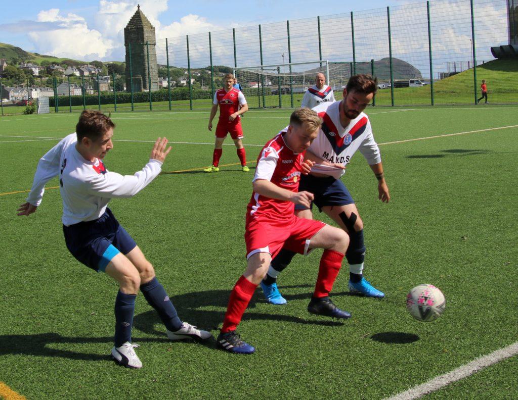 Pupils goal-scorer Donald McCallum fends off Red Star players.