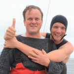 Matthew Bethell, right, celebrated with friend Eddie Blake onboard the safety boat after completing the swim.