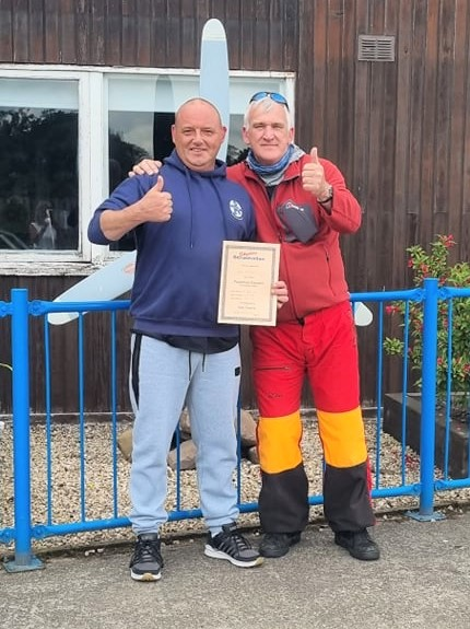 Jason McCallum, left, completed a tandem skydive to raise funds for SCAA.