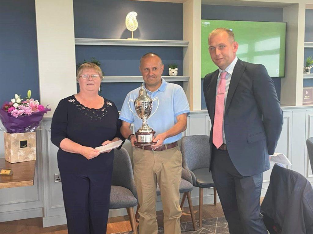 Trevor Wignall, winner of the David Irwin Memorial Trophy, centre, with David's partner Sheena Robertson and Machrihanish Golf Club's vice captainDarren Kelly.