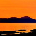 Gigha resident Keith Wilson submitted this photograph of the summer sun setting over Jura, as seen from West Tarbert Bay on the island.