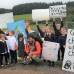 Rhunahaorine's pupils made banners and posters to greet coastal walker Chris Howard.