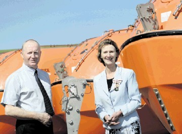 COMMITMENT: Angus Campbell with Carol Kinghorn at the marine-safety firm's Findon base. Kami Thomson