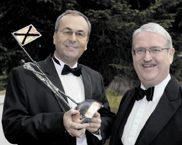 AWARD: Roy MacGregor, left, with Michael Urquhart, SCDI's Highlands and islands chairman