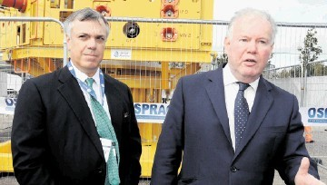 GROUNDBREAKING: Jim House, chairman of OSPRAG, left, with energy minister Charles Hendry pictured with the UK offshore industry's emergency capping device for use with a leaking well