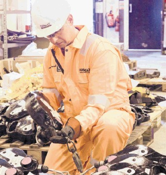 STRONGEST PERFORMER: A worker inspects equipment at Cosalt Offshore