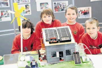Kingswells Primary School pupils Andrew McGrath, Flynn Johnstone, Craig Johnston and Ryan Johnston with their eco house