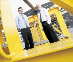 The 50-tonne winch dwarfs Rod Buchan, right, and Ace Winches chief operating officer Graeme Wood