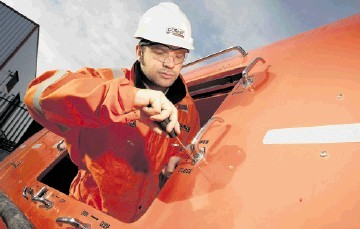 PROFITABLE DIVISION: Cosalt Offshore technician Iain Ridehalgh at work on a lifeboat