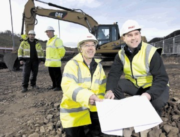 FORGING AHEAD:  Fraser Marshall, left, and Sean Pritchard study the development plans for the bioenergy plant at Glenlossie Distillery