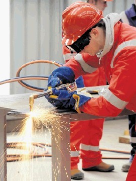 SPARKS FLY: Trainee welders at the Nigg centre. Sandy McCook
