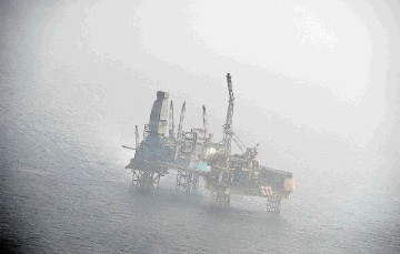 HAZY: The Elgin platform pictured during a flight which had to keep a security distance of three nautical miles around and 4.000ft above  the installation