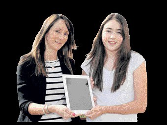 Mintlaw Academy pupil Rachel Massie receives her iPad from Tammy Fairclough of Shell St Fergus