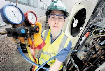 SAFE WORKING: Sodexo engineer Kris Holland checks Fairfield Energy's air conditioning at the oil company's Kirkhill Industrial Estate premises at Dyce, near Aberdeen. Kevin Emslie