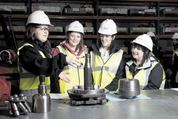 HANDS-ON EXPERIENCE:  From left, Mintlaw Academy pupils Katy Crawford, Abby Thompson and Rebecca Tosh with course co-ordinator Heather Sim  at  the Sparrows Group  base at Bridge of Don