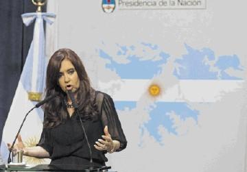 CAMPAIGN: President Cristina Fernandez explains Argentina's claim to the  Falklands. Inset: Roger Spink