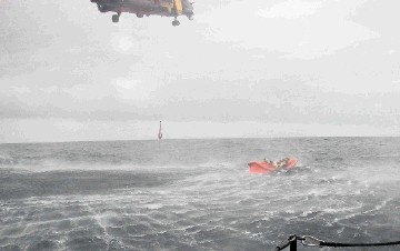 HIGH SUSPENSE: An RNLI  photo of passengers being rescued after the helicopter  they were travelling in ditched in the North Sea