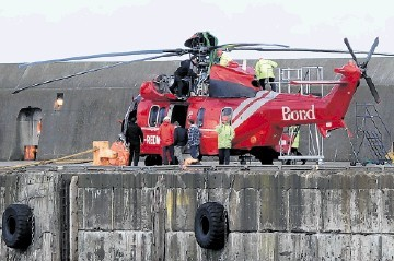 DITCHED: The downed aircraft  arriving at Peterhead Harbour last week after being recovered following the incident