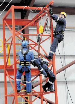 LOOKING UP: AquaTerra staff demonstrate equipment. Kenny Elrick