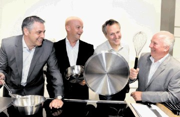 CREATING A STIR:  Nick Nairn, with Press and Journal Energy Ball 2012 sponsors, from left, Gavin Murray, Michael Lacey and Neil Bremner,  at the celebrity chef's Aberdeen cook school, in Back Wynd. Colin Rennie