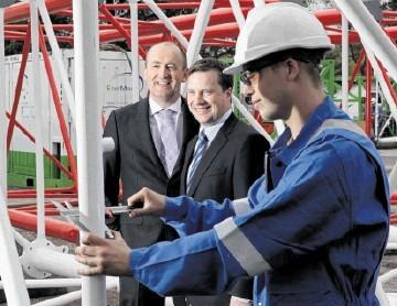 UPBEAT: Doug Duguid, left, and UK manager Stuart Smith watch Ryan Nicol working on a crane boom