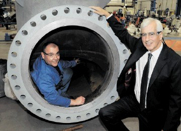 IN THE GROOVE: Maurice Critchley, CEO of Severn Glocon Group, with a machinist working inside a large oilfield valve assembly