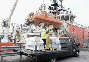 PROSPERING: Supplies from CIS are loaded on to a ship at Aberdeen harbour