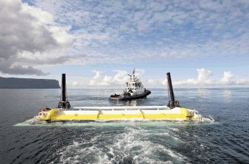 SEA POWER: A wave energy  converter is towed into position in the waters between Orkney and Caithness