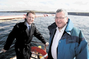 Greg Barker, left, and  Fergus Ewing  at the European Marine Energy Centre's  wave test site