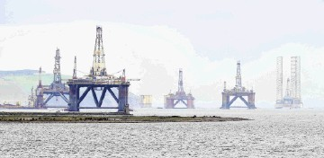 North Sea oil platforms sit in the Cromarty Firth.